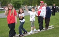 A Happy Family is participating in a cooperative ski challenge in the summer